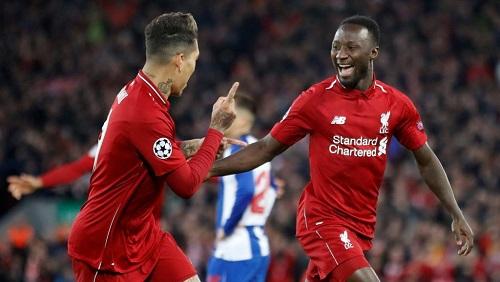 Le Guinéen Naby Keïta fête avec le Brésilien Roberto Firmino son premier but en Ligue des champions, avec Liverpool contre Porto le 9 avril 2019. © Carl Recine/Reuters