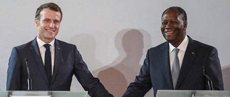 « C'est en entendant votre jeunesse que j'ai voulu engager cette réforme [du franc CFA] », avait lancé le chef d'État français à Abdijan, le 21 décembre 2019, aux côtés du président ivoirien Alassane Ouattara.  © LUDOVIC MARIN / AFP