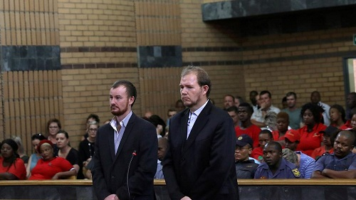 Pieter Doorewaard, 28 ans, et Philip Schutte, 35 ans, accusés du meurtre d'un adolescent noir