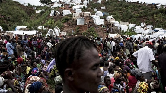 Kalemie, sud-est de la RDC, au bord du lac Tanganyika. Des déplacés attendent la distribution de vivres le 20 mars 2018 (image d'illustration). © John WESSELS / AFP
