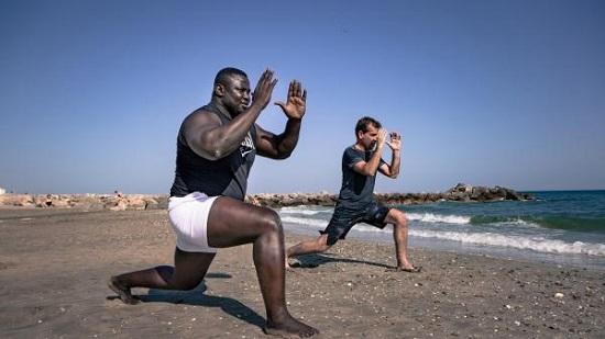 Serigne Ousmane Dia allias (Bombardier ) avec son coach Luc Estienne © Cathy Cohen