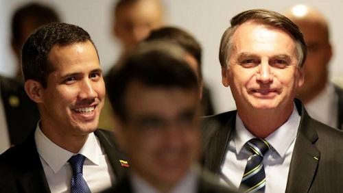 Le leader de l'opposition vénézuélienne, Juan Guaido et le président brésilien, Jair Bolsonaro, avant leur conférence de presse à Brasilia, le 28 février 2019. REUTERS/Ueslei Marcelino