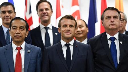 Emmanuel Macron et Jair Bolsonaro, le 29 juin 2019 à Osaka, lors du sommet du G20. Brendan Smialowski / AFP
